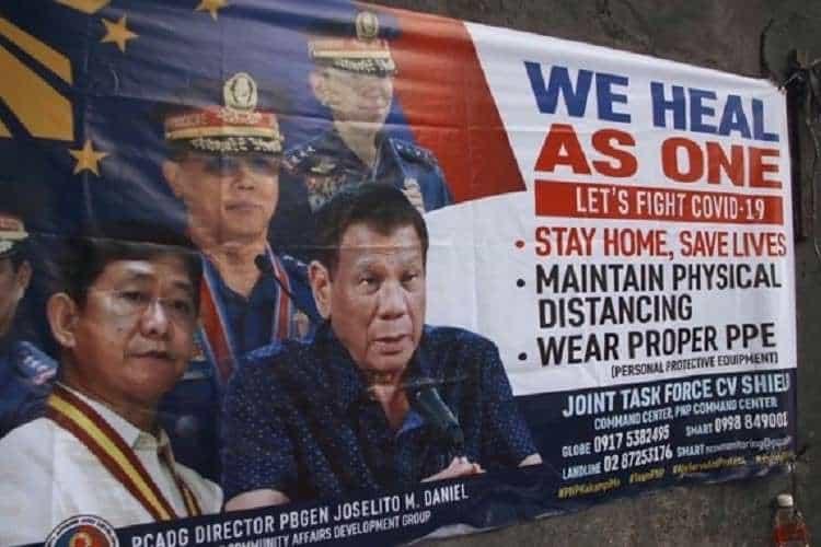 poster for philippines coronavirus quarantine stating we heal as one