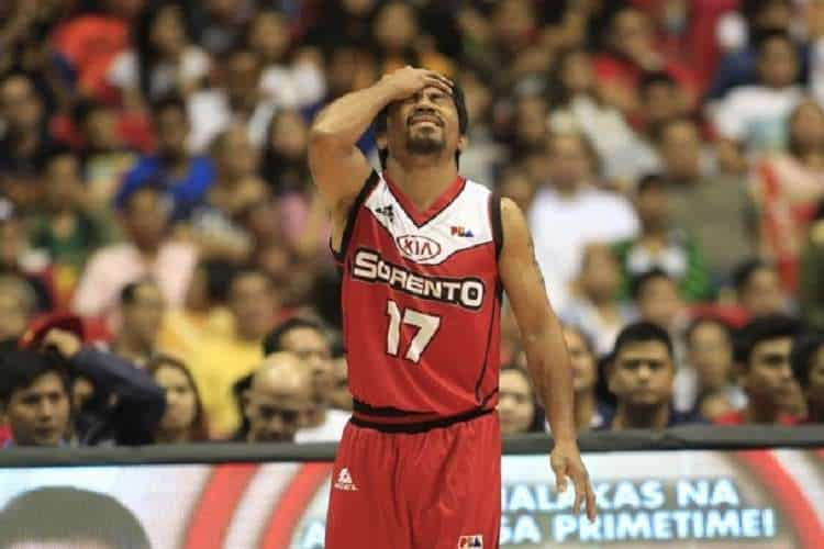 manny pacquiao clutching his head on the pba court