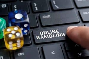 keyboard with dice and an online gambling key being pressed